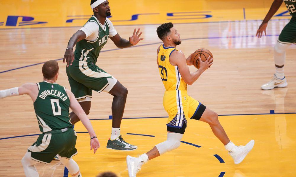 Curry vitória Warriors Bucks